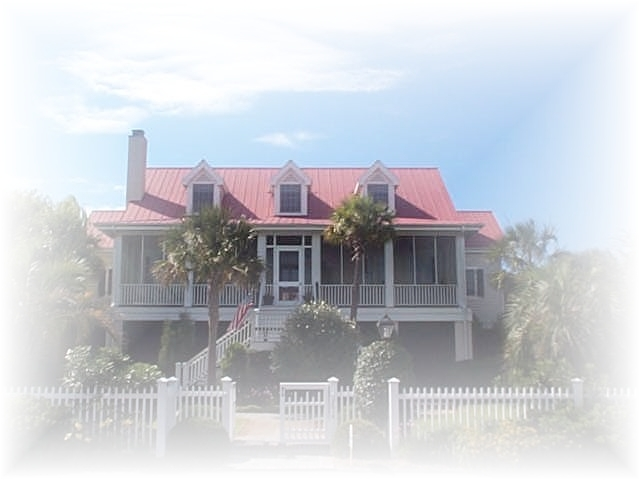 sullivans island home with red metal roof
